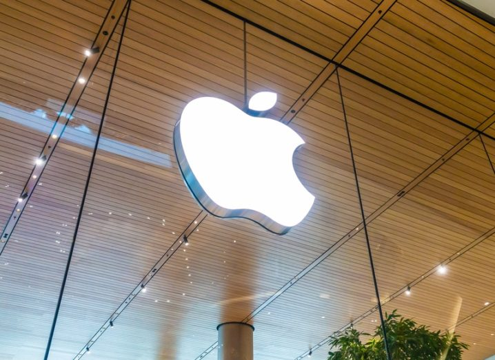 Apple logo on a glass panel, part of a retail store in Bangkok.