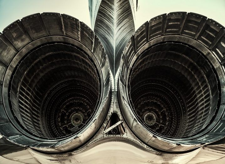 Close-up of two jet engines on a fighter jet.
