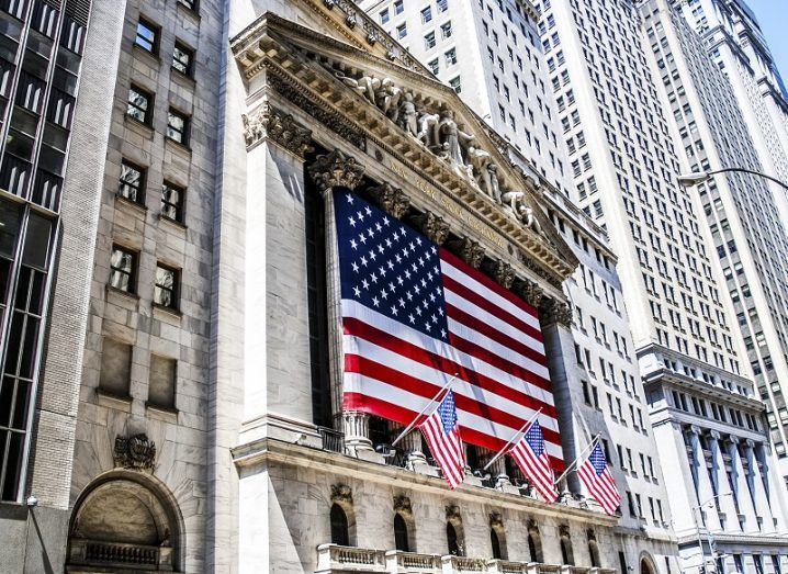 An American flag hanging on the front of the New York Stock Exchange building in New York City.