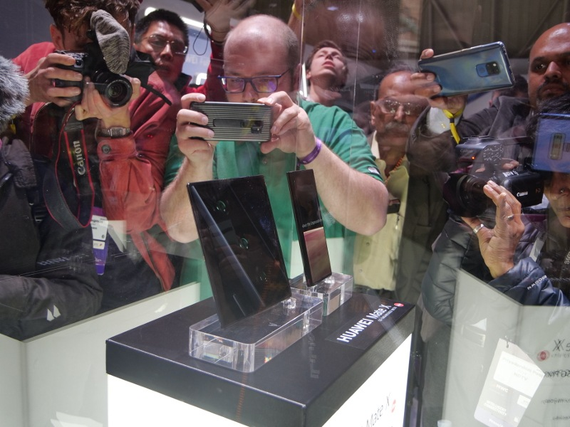 Journalists and photographers take pictures of the first foldable 5G phone from Huawei during Mobile World Congress in Barcelona.