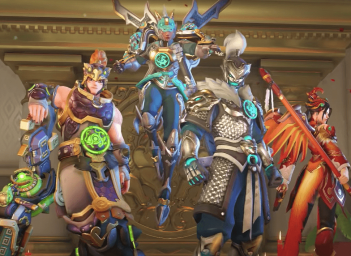 Characters from the Activision title Overwatch. They are wearing colourful battle armour.