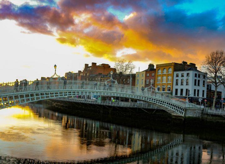 Dublin night scene with Ha'penny bridge and Liffey river lights