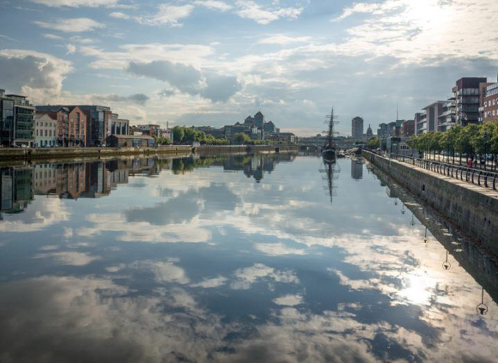 A beautiful sunny day in Dublin with the sky reflecting mirror-like on the Liffey along the IFSC and Silicon Docks end of the city.