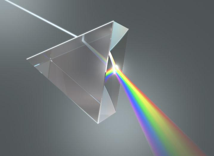 Crystal prism disperses white light into many colours.