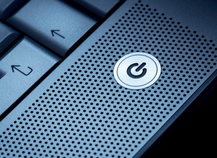 close-up of grey power button on laptop.