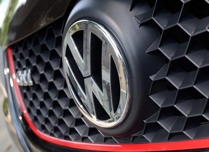 Close-up of a grill on a black Volkswagen Golf GTI with red trim.