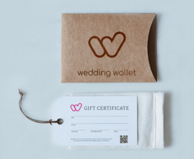 Picture of a brown envelope and Wedding Wallet gift certificate on white table.