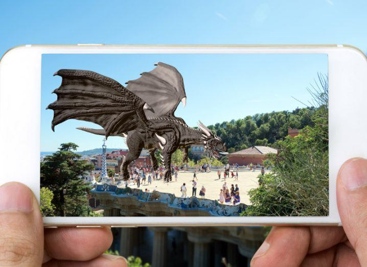 Example of an AR game with a dragon rendered over a real view of a city through the lens of a smartphone.