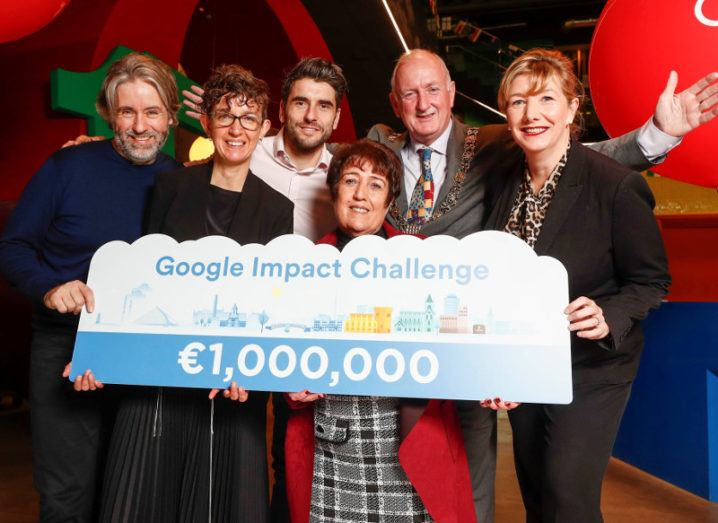 A group of people including three men and three women holding a sign for the one million euro Google Impact Challenge for Dublin.