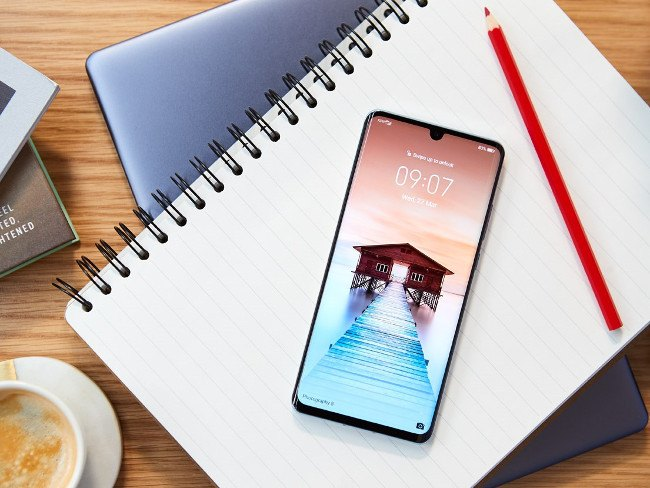 New Huawei P30 device on a notebook page.