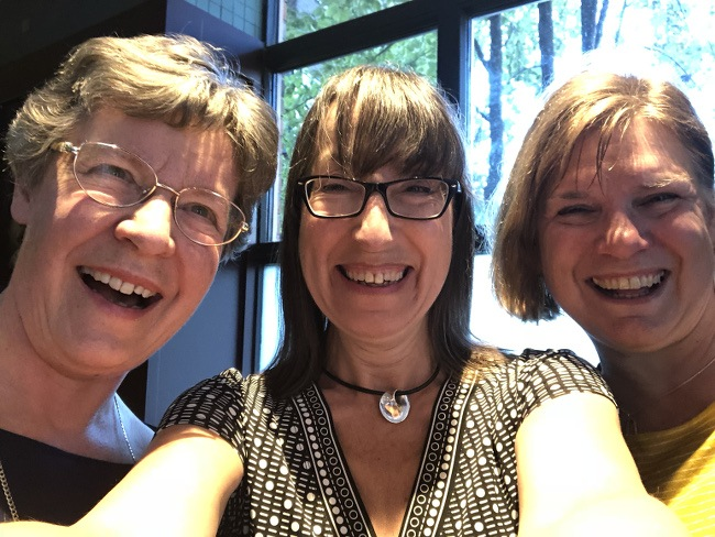 Selfie of three women, laughing and smiling.