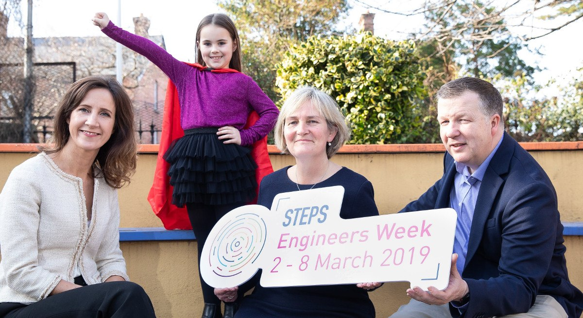 Two women and a man beside a little girl doing a superhero pose to mark launch of Intel and Engineers Ireland STEM skills initiative.