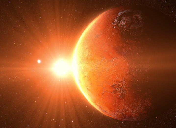 A depiction of the sun from the red planet of Mars.