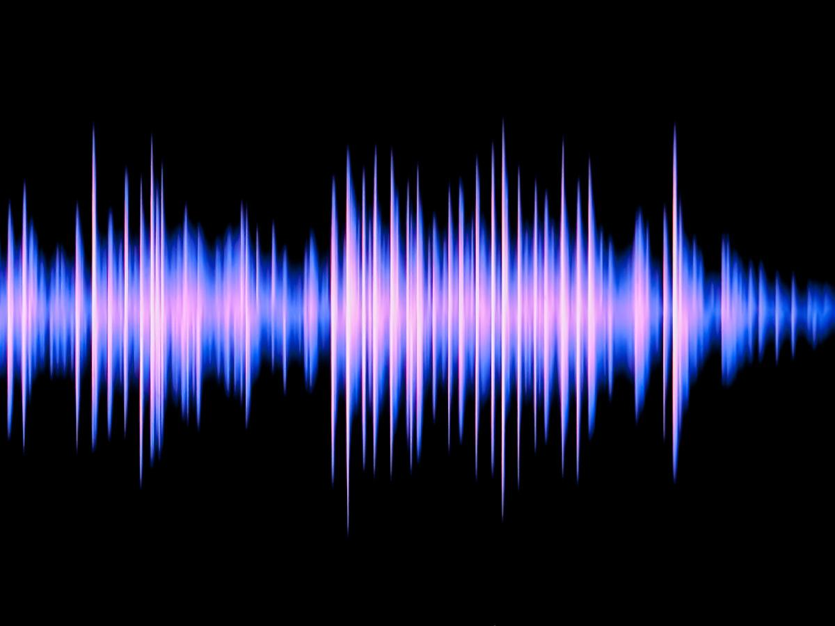 A black background with a blue-purple sound wave passing through the middle.