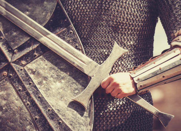 Picture of a knight holding a shield and a sword to denote the modern task of cybersecurity defences.