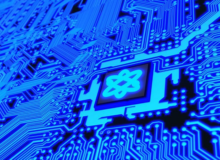 Circuit board in blue with a chip and a molecule symbol denoting quantum computing.