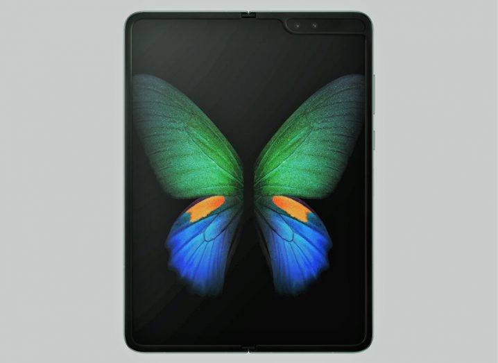 Hero shot of an opened up Galaxy Fold smartphone displaying a colourful butterfly.