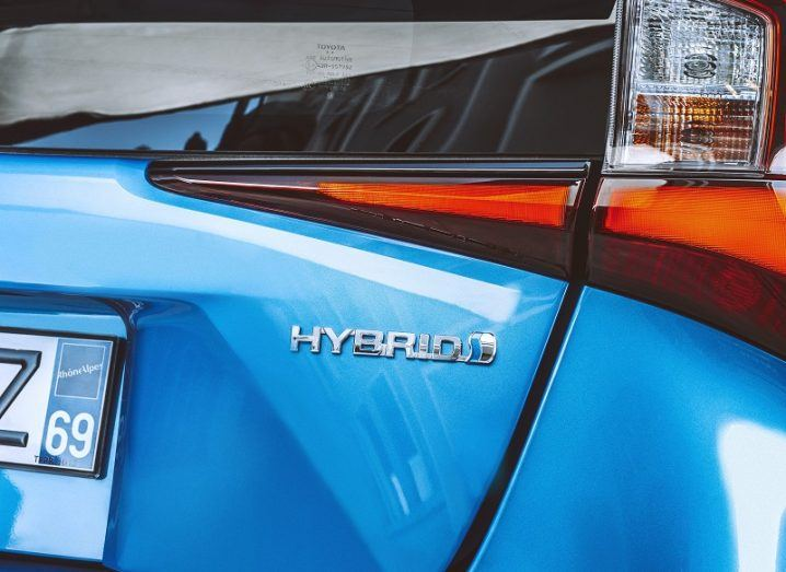 Close-up of the hybrid sign on the rear of a blue 2019 Toyota Prius.