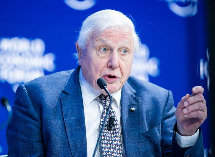 David Attenborough speaks about climate change on a World Economic Forum stage.