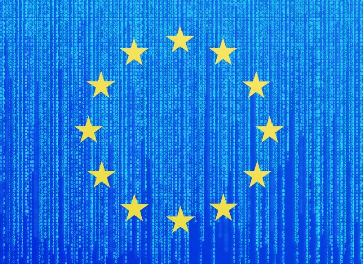A circle of 12 gold stars on a blue background of lines of binary data, representing the European Union flag.