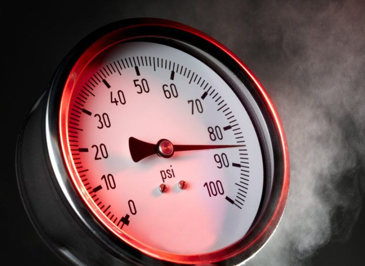 Close-up of the dial of a pressure gauge, where the needle is nearing 90.