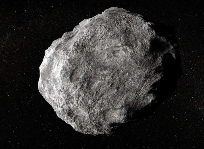 Illustration of a large asteroid drifting through space.
