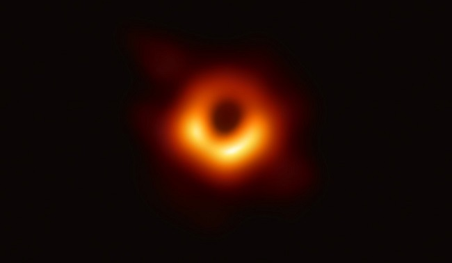 A golden ring surrounding the black hole event horizon.