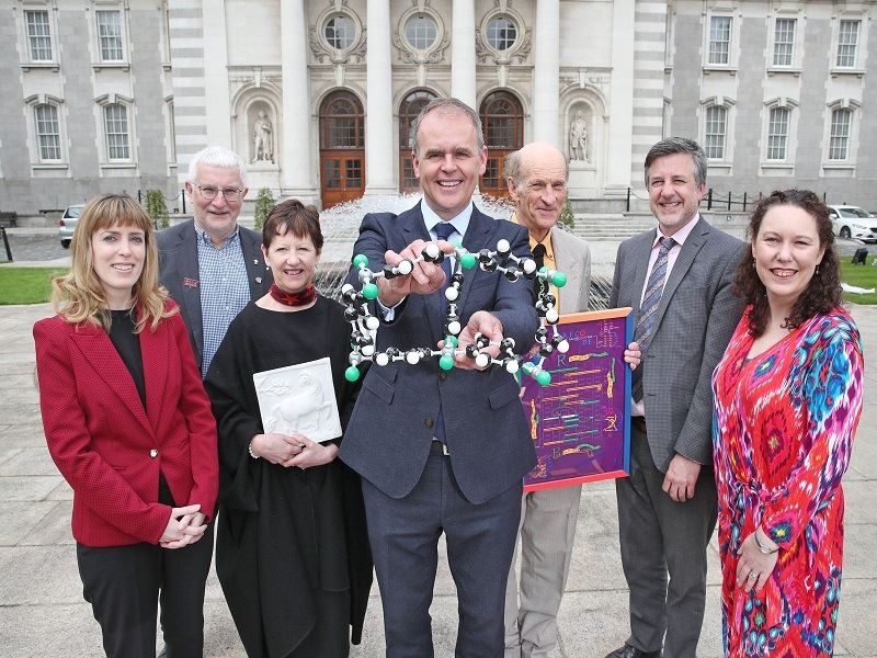 Irish Research Council members and researchers posing for a photo in front of Leinster House.