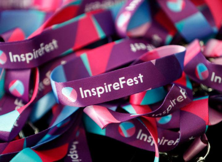 A pile of Inspirefest-branded lanyards coloured in purple, pink and blue hues.