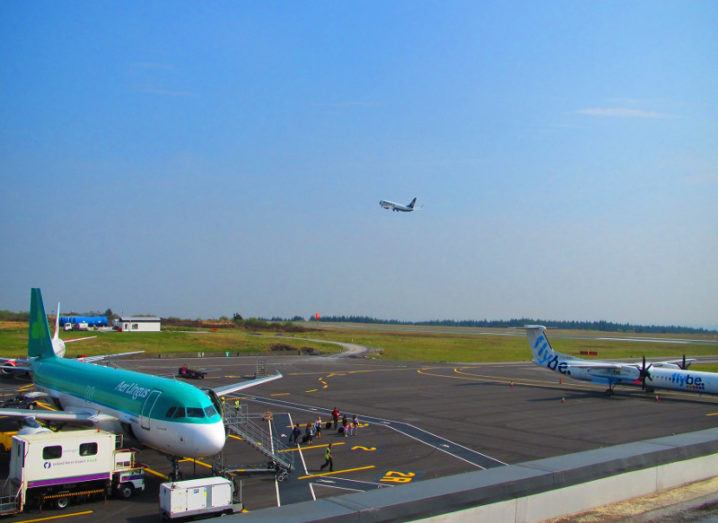 The runway with planes at Ireland West Airport Knock in County Mayo under a blue sky.