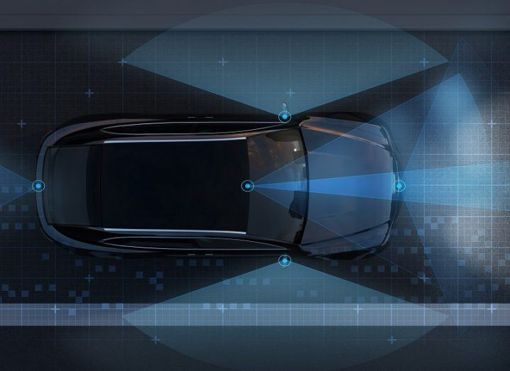 Concept birds-eye view of LiDAR sensors scanning the surroundings of a car on a road.