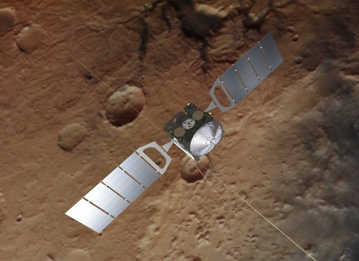 The Mars Express orbiter shown above the surface of Mars.