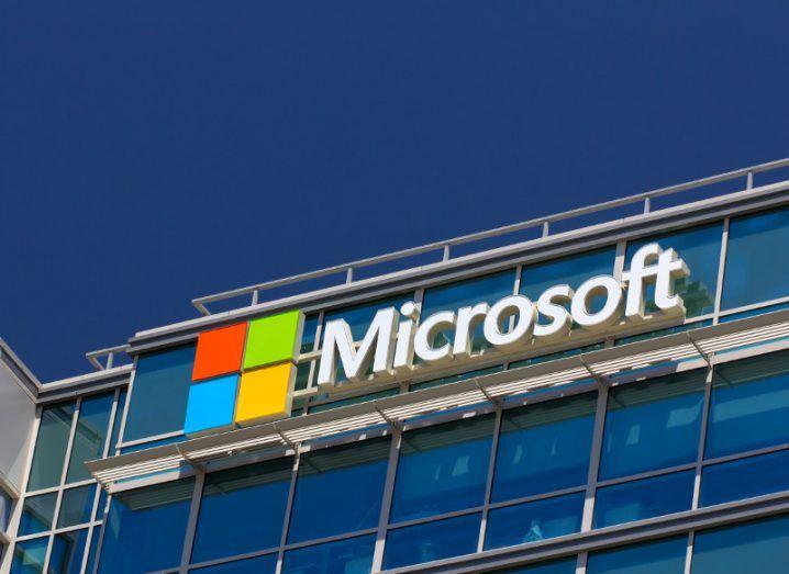 Microsoft corporate building under a blue sky.