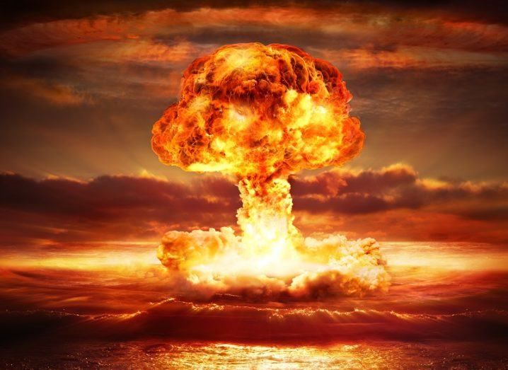 Illustration of a bright orange mushroom cloud caused by an atomic bomb.