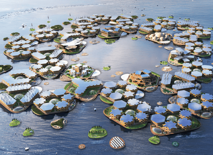 3D render of Oceanix City made from a series of hexagons with a central open body of water, surrounded by ocean.