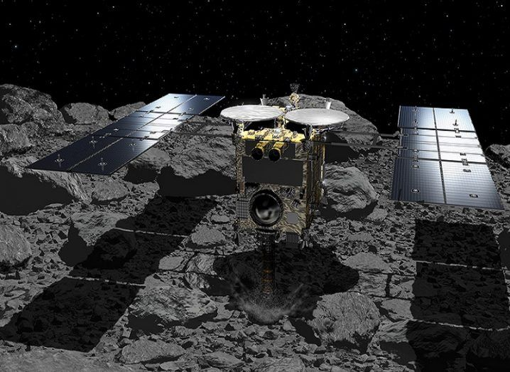 Illustration of Hayabusa 2 touching down on the surface of Ryugu.