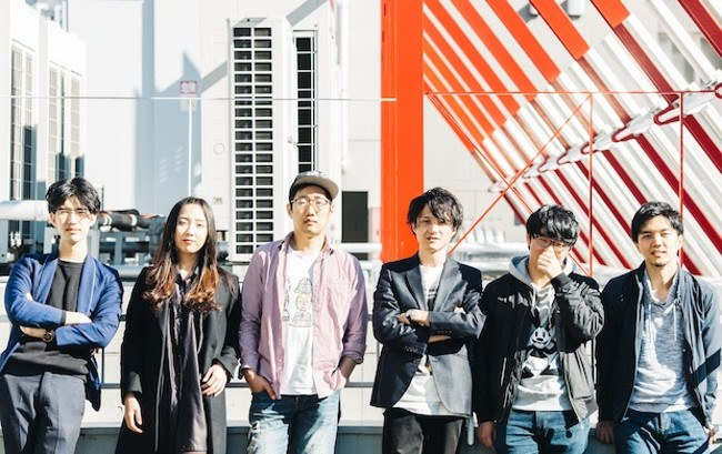 Group of young Japanese tech founders leaning against a wall.