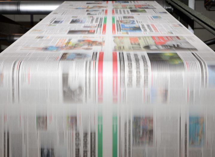 Image of newspapers being printed in colour on an offset press.