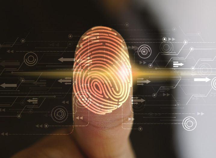 A person puts a finger on a fingerprint scanner.