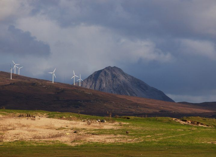 A view of a wind farm on a hillside in Donegal under a ceiling of clouds.