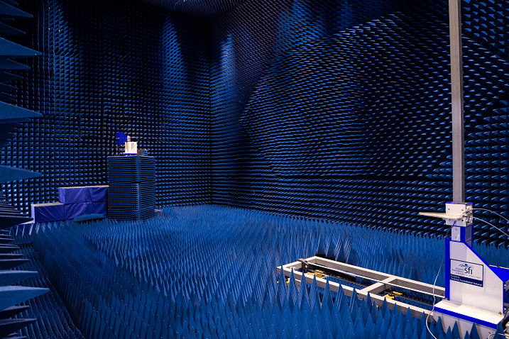 The interior of the test centre covered in blue, sharp conical shapes and a testbed in the right foreground.