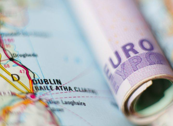 Euro banknotes on a geographical map of Dublin.