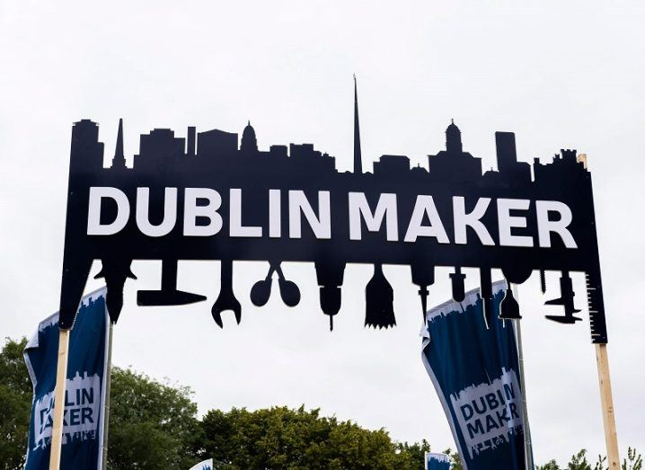 Looking upwards at the Dublin Maker sign at the entrance of the event with a grey sky in the background.
