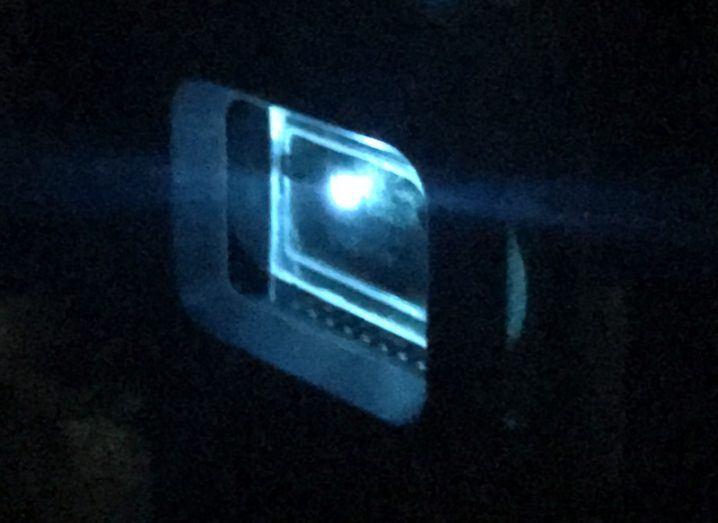 Blue light emitting from an organic laser diode.