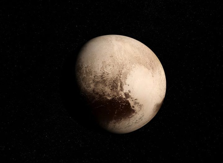 Pluto and its heart-shaped basin against a black background.