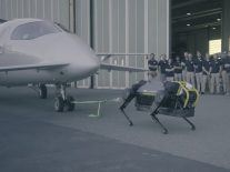 Watch a dog-like robot struggle to pull a much larger aircraft