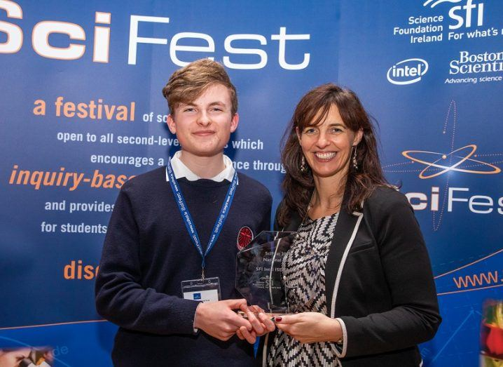 Adam Kelly being presented with his SciFest 2018 trophy.