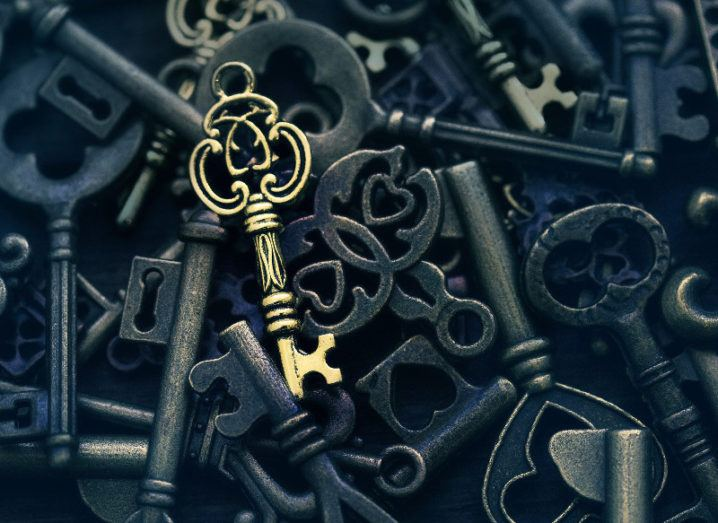 One golden key on a background of different vintage keys.