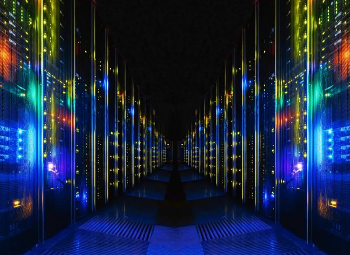 View of multicoloured servers and mainframes in a row in a data centre.