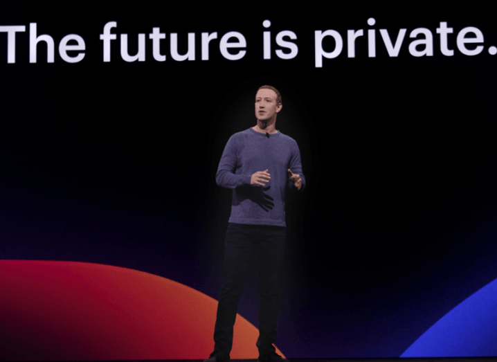 Mark Zuckerberg on stage with the words The Future is Private on a screen behind him.